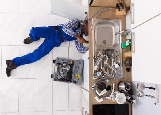 plumber-under-sink
